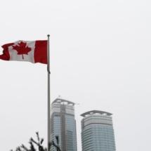 canadian-flag-pole-overcast-sky